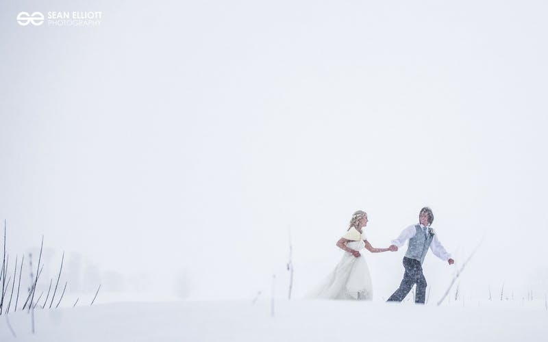 Newlywed couple in the snow