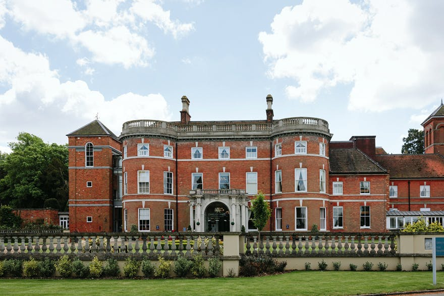Oakley Hall Park and Hotel Grand Wedding Venue in the UK in Basingstoke, North Hampshire, England - Beautiful Vintage Red Brick Wedding Venue in England - Jacques Lloyd Real Simple Photography | Confetti.co.uk