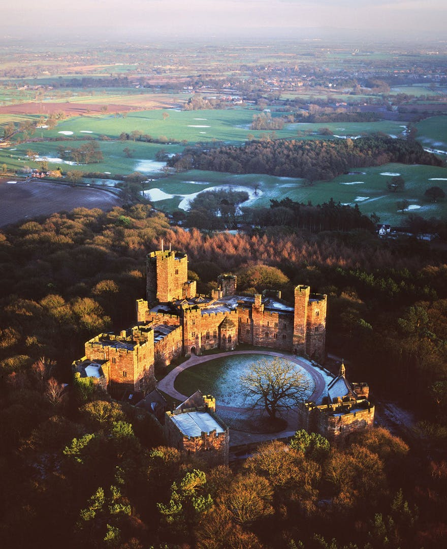 Peckforton Castle Cheshire Wedding Venue - Medieval Castle Style Victorian Country House - Castle Winter Sunset - Castle Wedding Venues in the UK | Confetti.co.uk