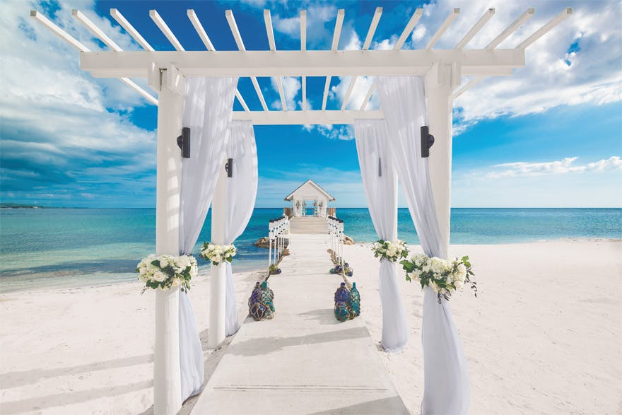 Sandals South Coast Jamaica Over the Water Chapel and Beach Aisle - Caribbean Beach Wedding | Confetti.co.uk