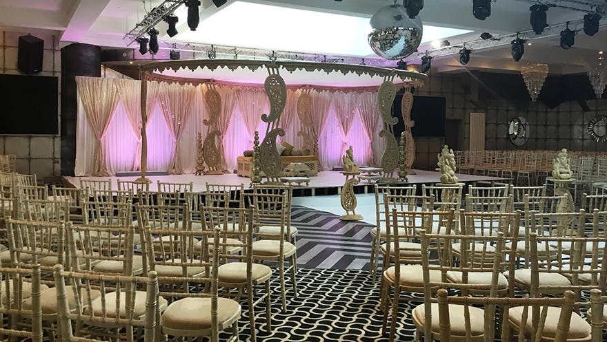 Asian Weddings at Old Thorns Hotel - Old Thorns Grand Ballroom with Gallery and Garden - Asian Wedding Ceremony and Reception Venue in Hampshire - Wedding Thrones and Beautiful Drapes Backdrop | Confetti.co.uk