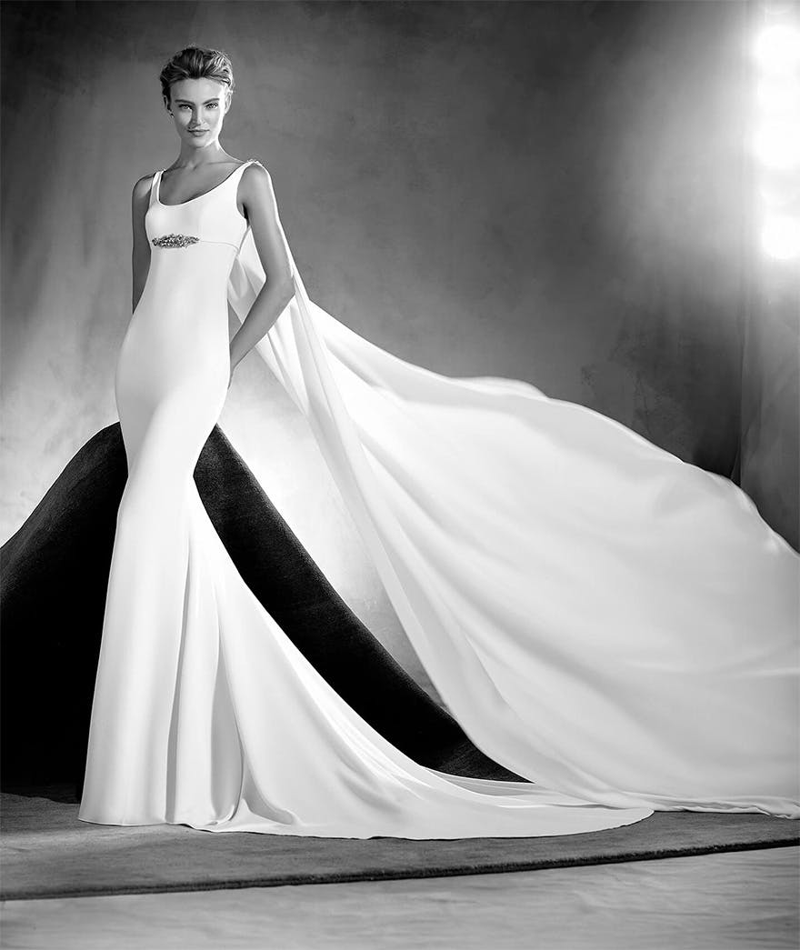 Superhero Wedding Dress - Edurne by Pronovias Atelier - Simple and Beautiful Mermaid Wedding Dress with Round Neckline, Thin Straps, Long Fluid Cape and Gemstone Details - Wedding Dresses with Capes | Confetti.co.uk