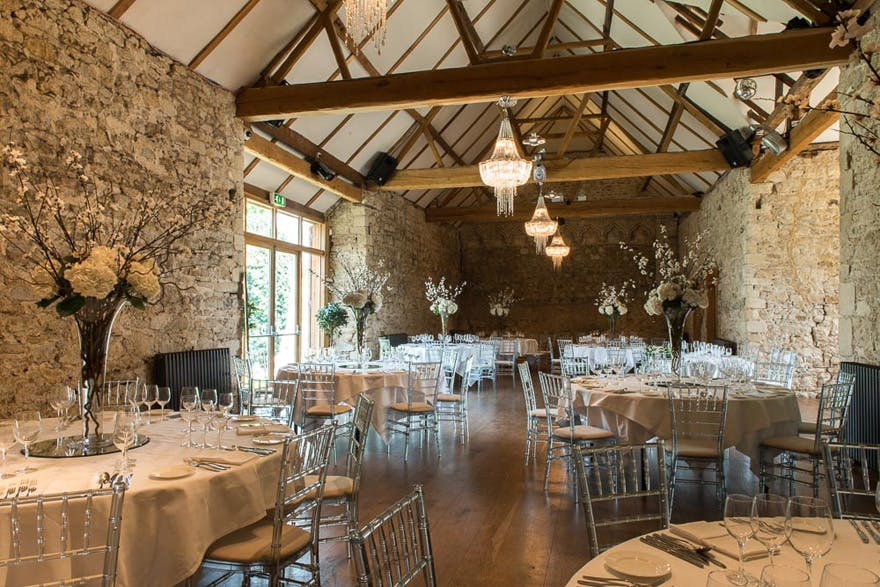Beautiful Barn Wedding Venues in in Oxfordshire - Notley Abbey Historic Barn Wedding Venue - The Monks' Refectory Rustic Glam Wedding Reception | Confetti.co.uk