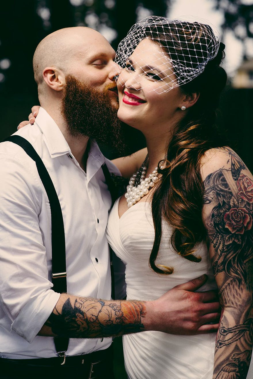 Danielle and Rob's Pin-up Style Meets Comic Books Wedding by Bouncy Robot Photography - Tattooed Bride and Groom | Confetti.co.uk