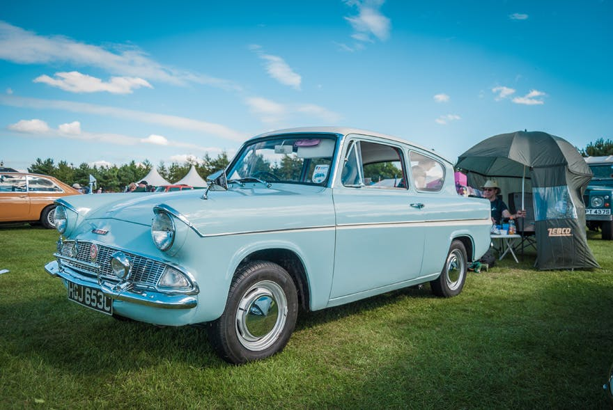 1960s Sky Blue Ford Anglia at the Croft Circuit Nostalgia Weekend co Durham, England by Neil Gardner on Shutterstock - Harry Potter Wedding Transport Ideas - Harry Potter Ford Anglia | Confetti.co.uk