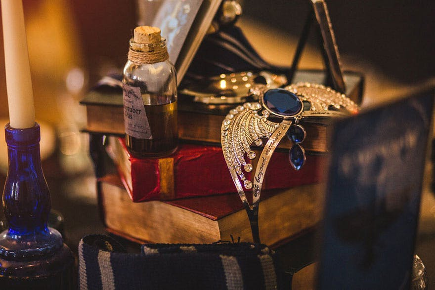 Harry Potter Themed Wedding by Kelly Clarke Photography - Diadem of Ravenclaw - Piled Books Harry Potter Wedding Centrepiece Idea | Confetti.co.uk