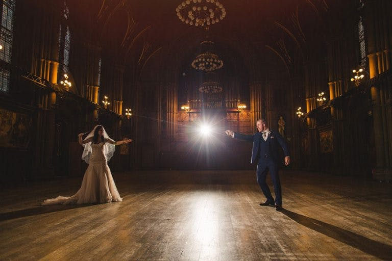 Lewis and Cassie's Harry Potter Themed Wedding by Kelly Clarke Photography - Bride and Groom Harry Potter Magic Wands Photo Idea | Confetti.co.uk
