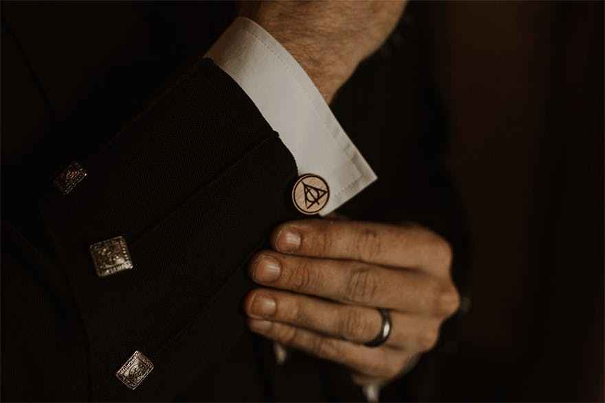 The Deathly Hallows Symbol Cuff Links - Harry Potter Inspired Scottish Castle Wedding by The Curries Photography | Confetti.co.uk