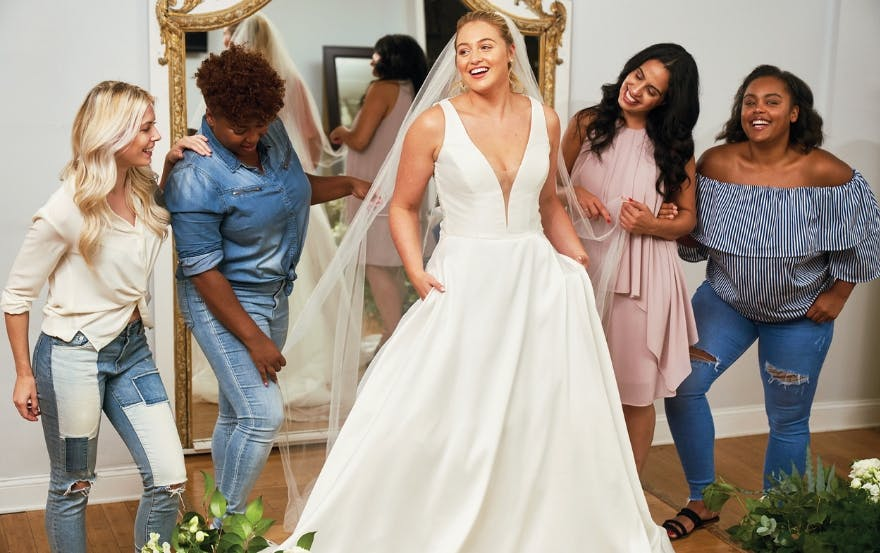 Bride trying on Justin Alexander wedding dress