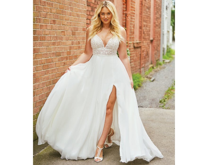 Bride with thigh-split wedding dress