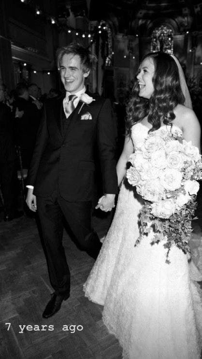 Tom and Giovanna Fletcher on their wedding day black and white with flowers