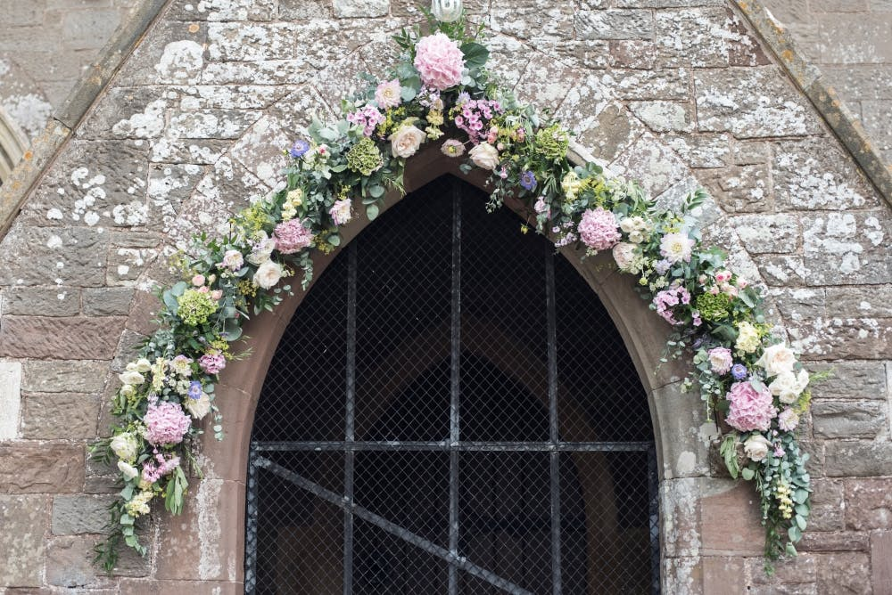 floral-wedding-arch-for-church-wedding