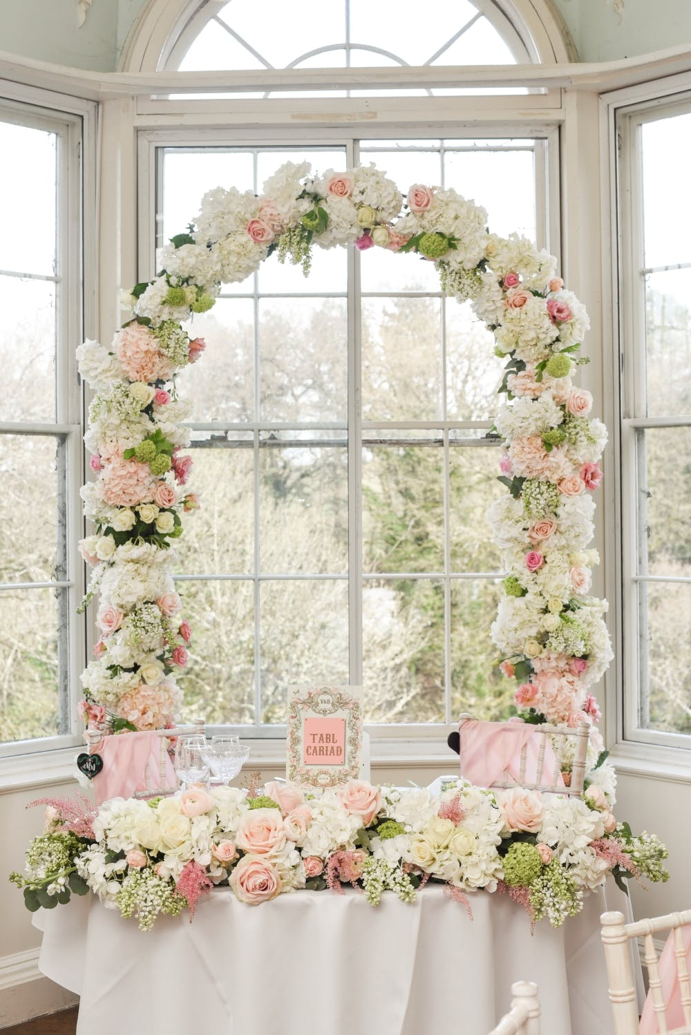 pink-and-white-floral-wedding-arch