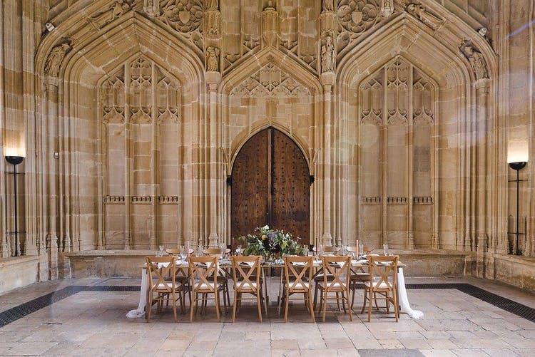 Intimate dinner in Divinity School - Weddings by Nicola & Glen