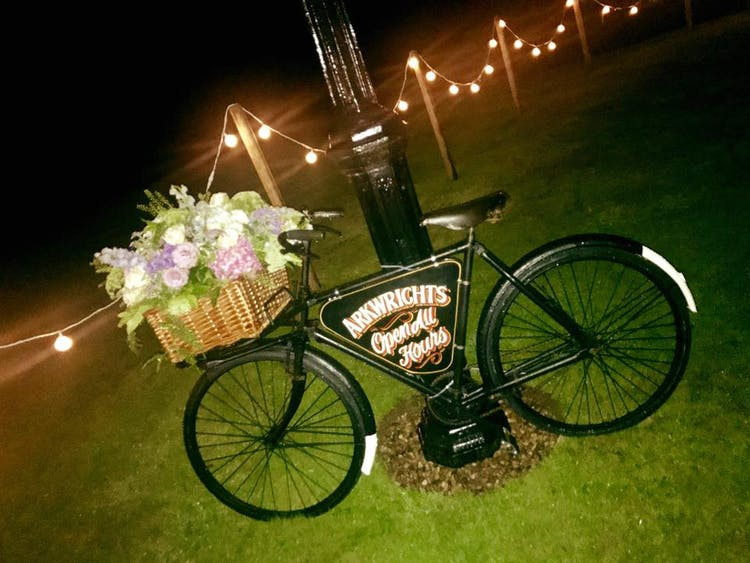 A vintage bakers bike doubles up as a floral wedding display.