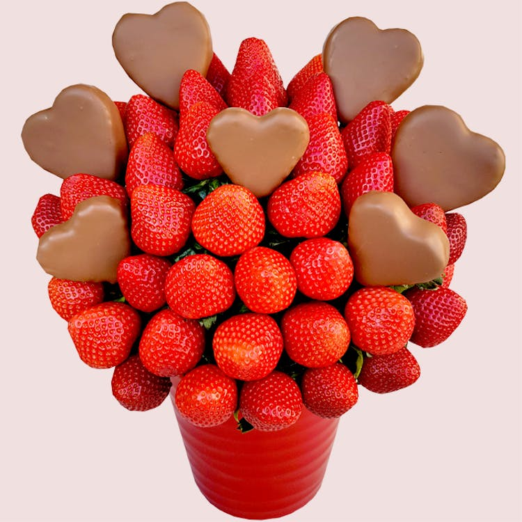 "Valentine's Hearts Strawberry Bouquet is just the right gift to say ""I Love You"" on Valentine's Day… or any day of the year. By sending this gorgeous arrangement you are sending your love and your heart! We guarantee that the recipient will be thrilled!"