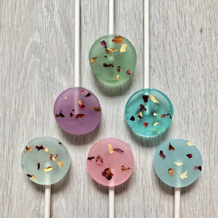 Pastel coloured lollies with edible rose petals