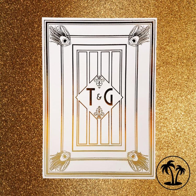 Luxurious Art Deco inspired invitation suite finished in gold foil
