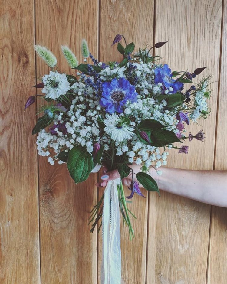 Fun, meadow bouquet with seasonal blooms. Photo Credit: Romeo & Succulent