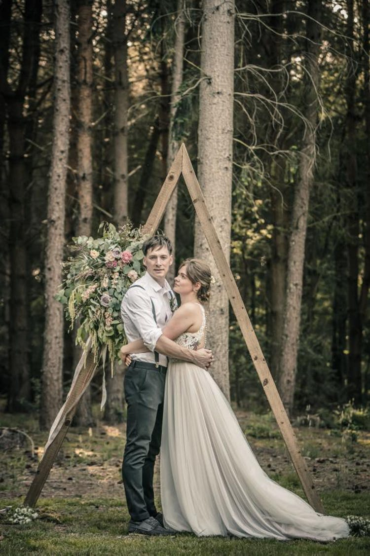 Rustic, woodland wedding with our hired triangular archway and statement flowers. Photo Credit: James Neale Photography