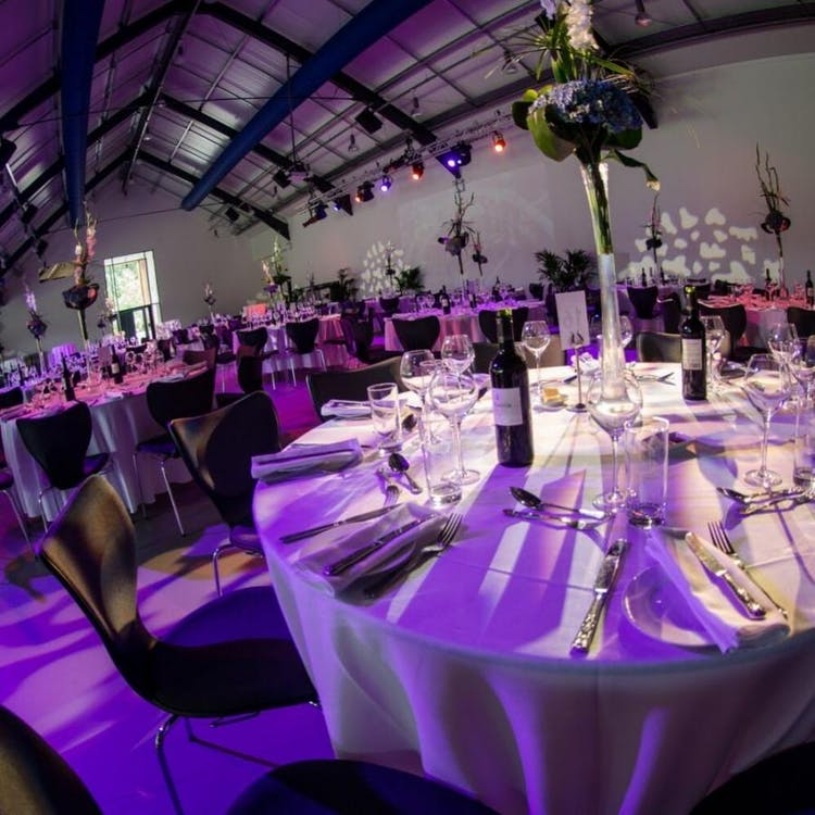 Wedding breakfast with round tables in The Longhouse