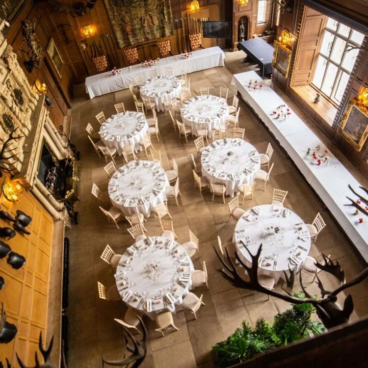 The Great Hall set for a ceremony with round tables