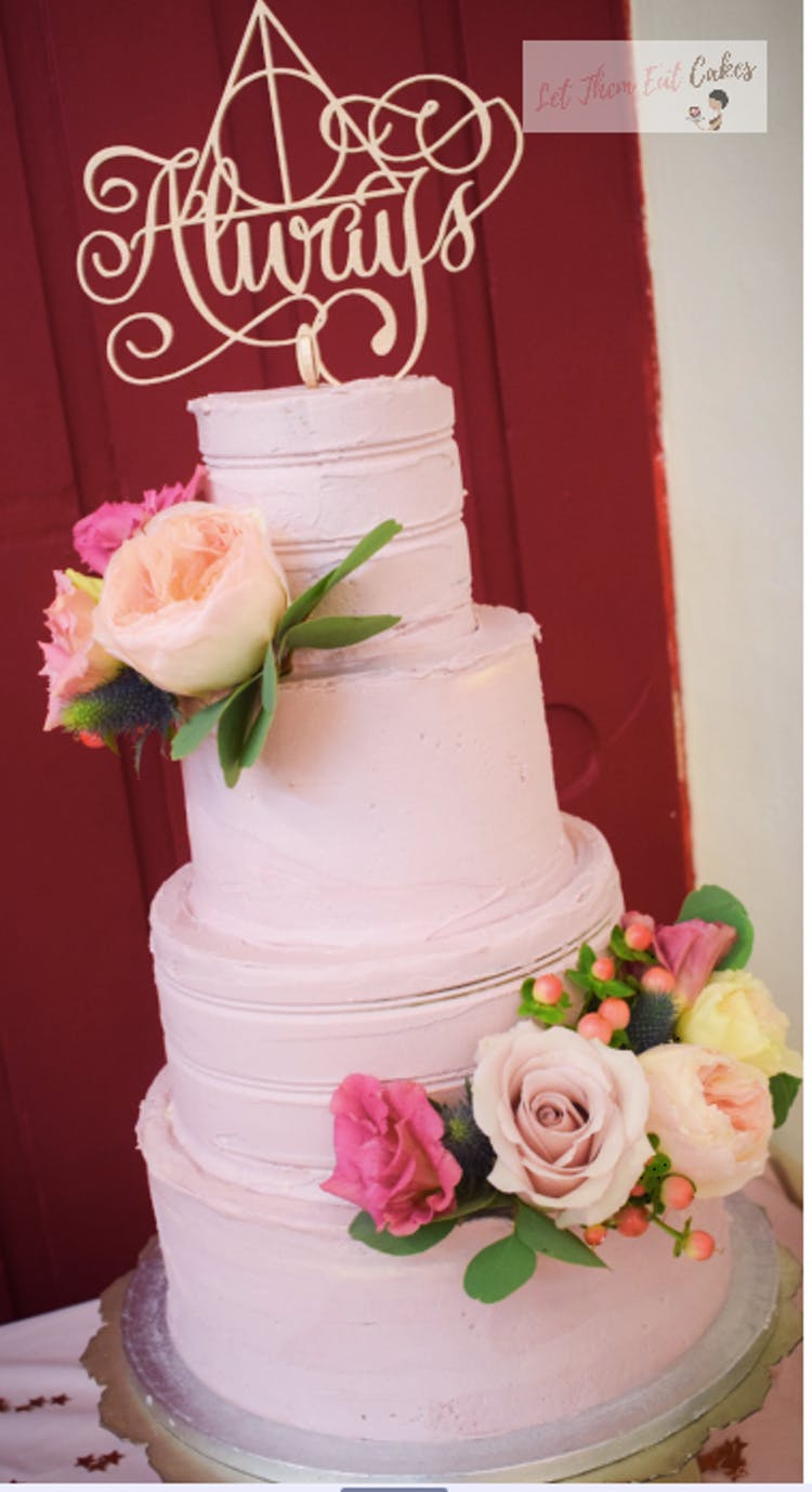Buttercream wedding cake with fresh florals in blush nude
