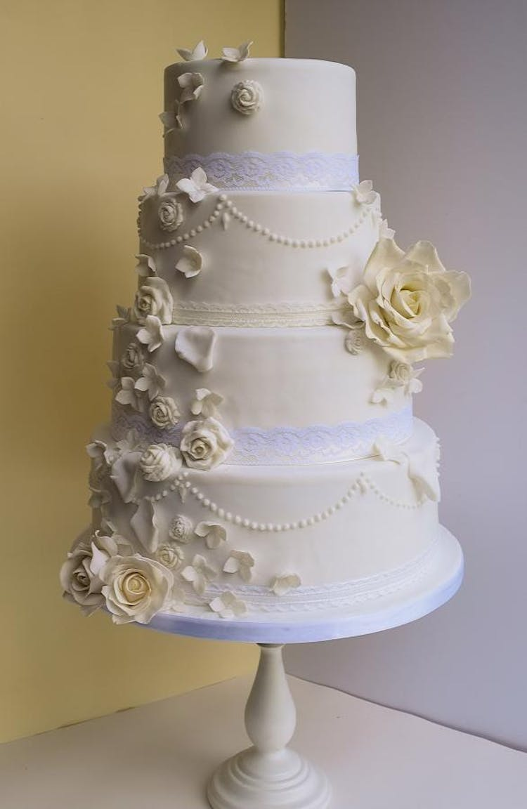 Classic White Wedding Cake with Handcrafted Sugar Roses