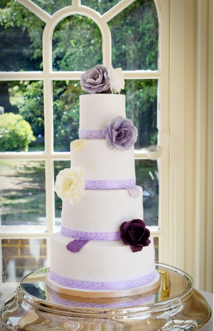 Purple and Lavender Wedding Cake with wafer roses