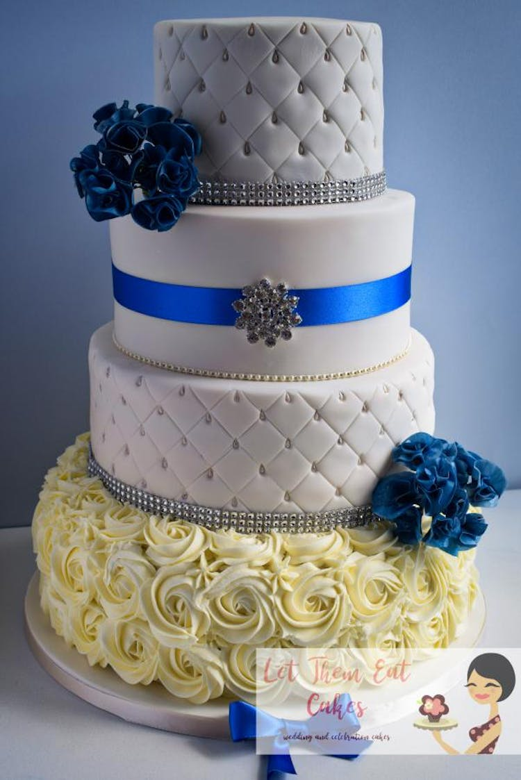 Diamante and Royal Blue wedding cake with blue wafer floral sprays