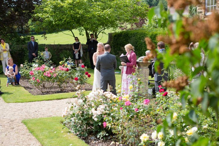 A Happy couple getting married outside at our pavilion at Middle Aston House