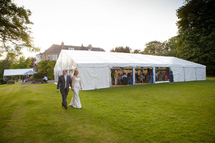 Marquee on the from lawn with Middle Aston House in the distance