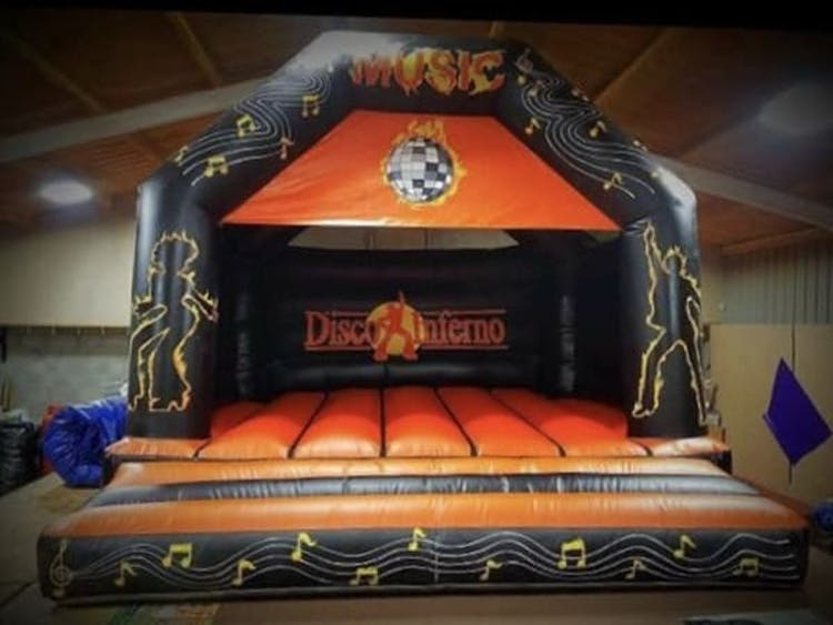 Disco Inferno Bouncy castle with optional Bluetooth speaker and disco lights.