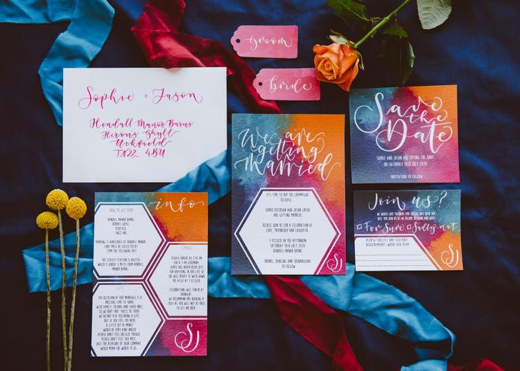 vibrant watercolour and calligraphy invitations