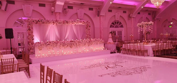 Head Table Perfection with Floral Arch and Candles