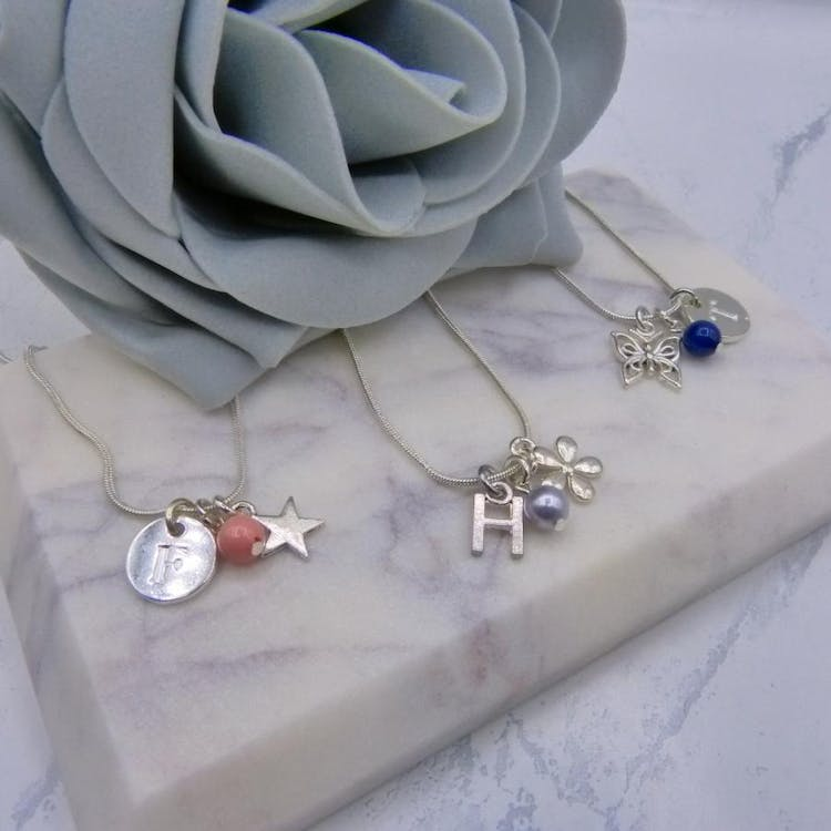 Lets not forget your Adorable Flower Girls. Lovely Keepsake Necklace with Choice of Charms and Initial Design, along with a Colour Coordinated Pearl in over 50 Colours from Swarovski® Elements. £9.00