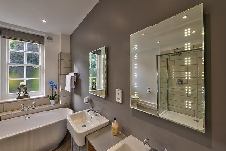 Bridal Bathroom with double showers and sinks